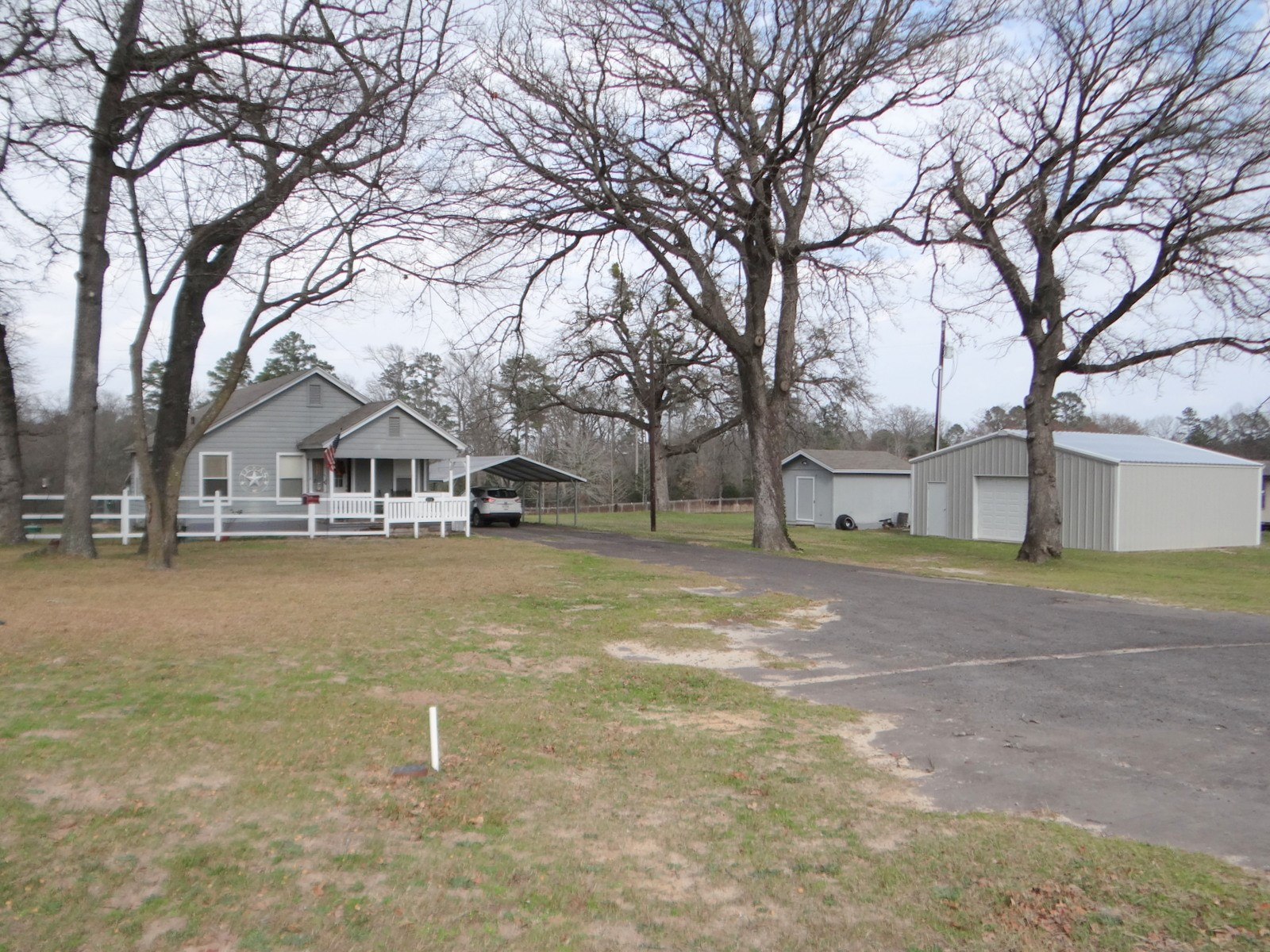 3 EAST TEXAS ACRES - LARGE POND + WORK SHOP + HOME FOR SALE