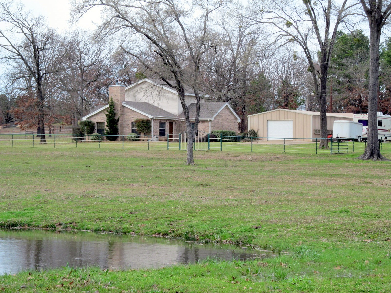 12 EAST TEXAS ACRES - LARGE HOME - POND - SHOP FOR SALE