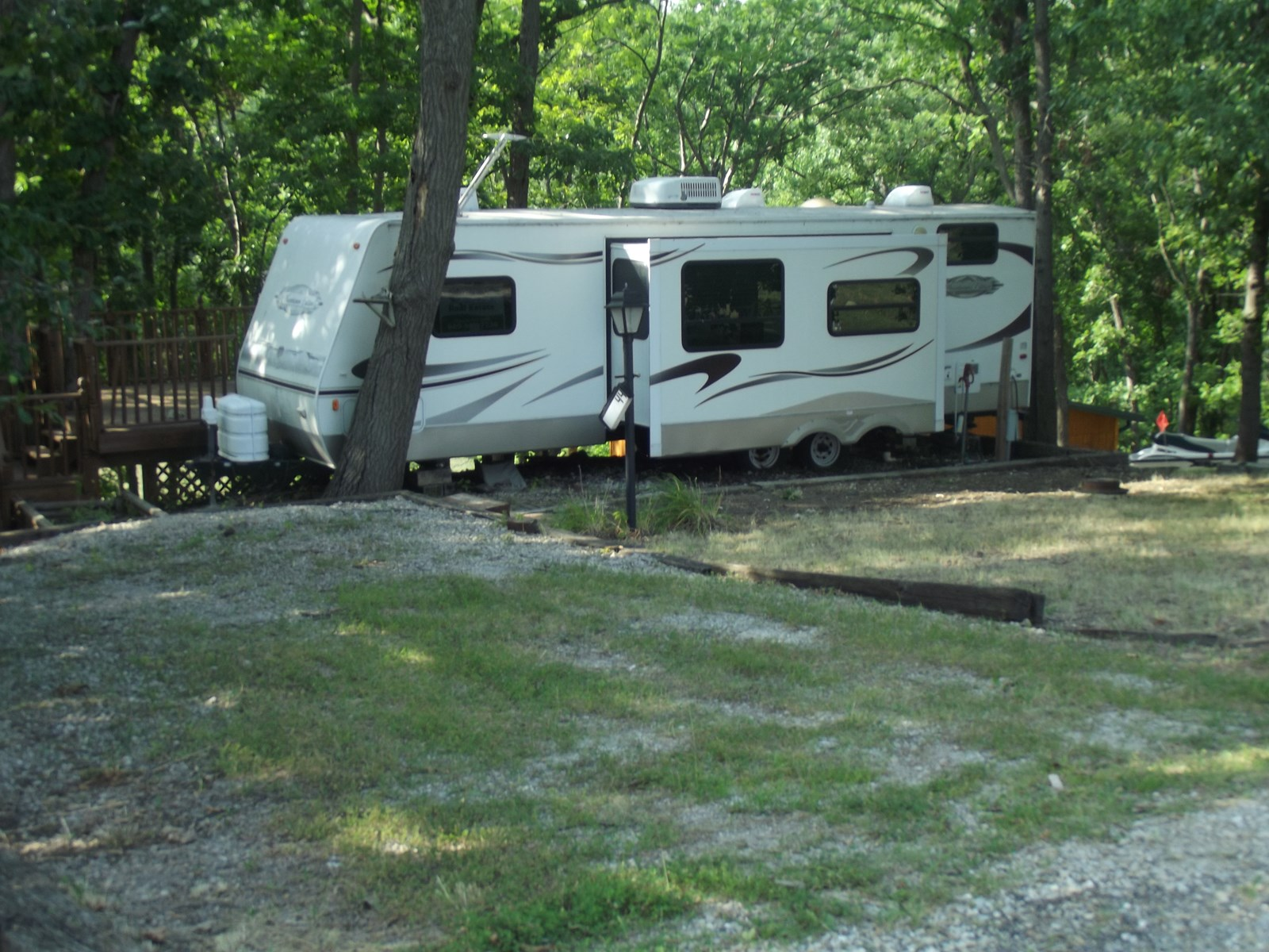 Waterfront lake lot with camper for sale at Lake Thunderhead
