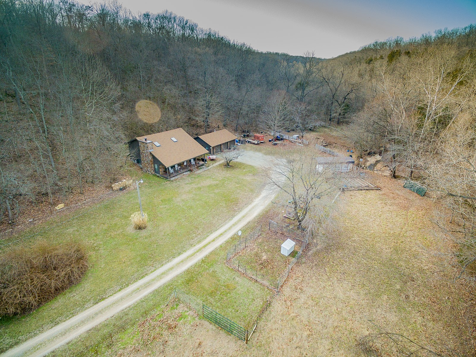 Home w/3 car detached garage on 62.98 AC in Seligman, MO