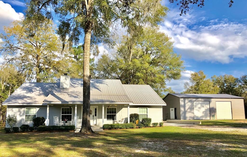 Energy Efficient 3/2 country home on 10 acres w/ pond