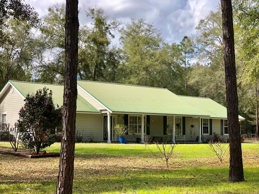 3/2 country home on 12.68 acre pine treed income property