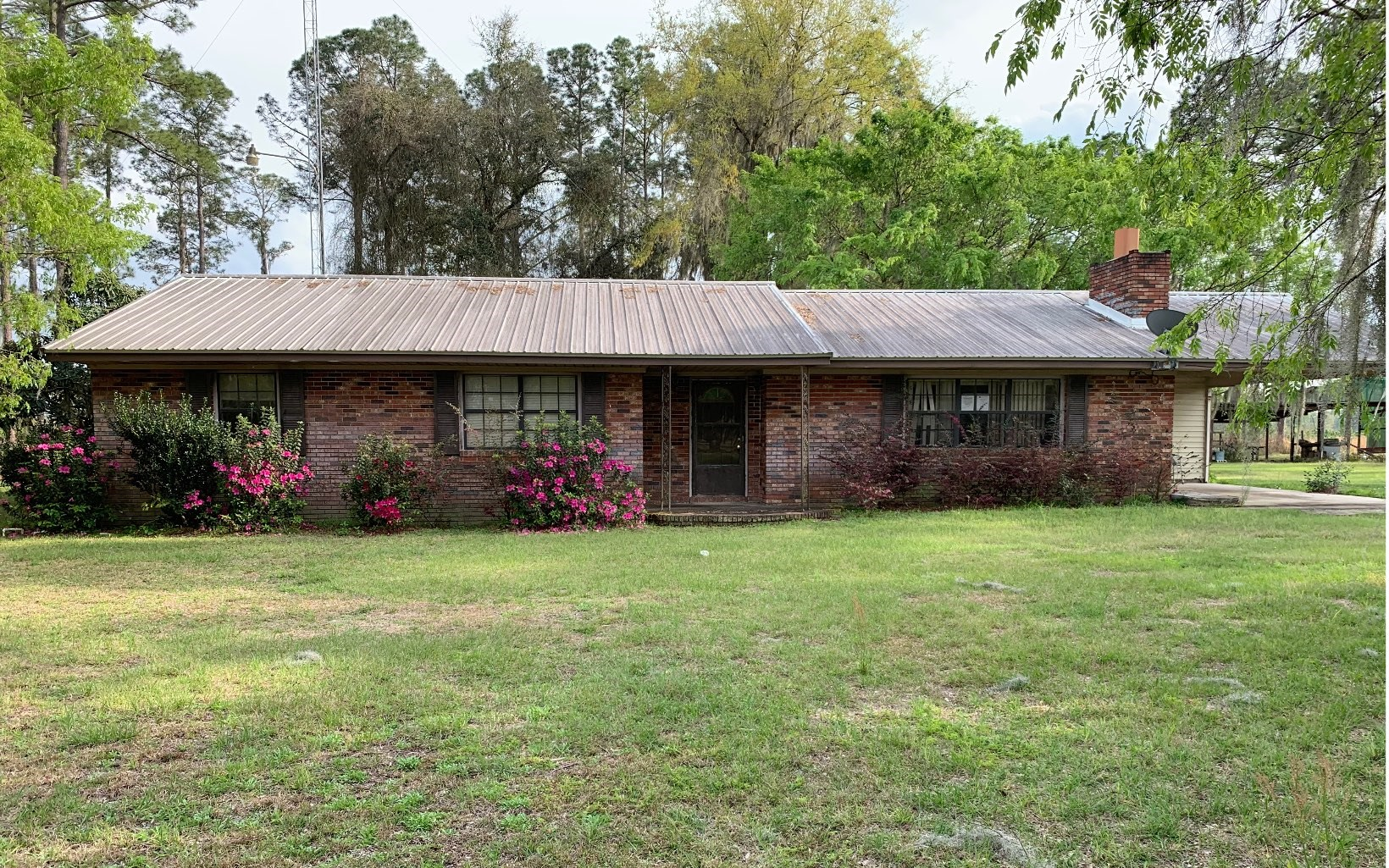 4 bedroom, 2 bath brick home on 5.77 acres.