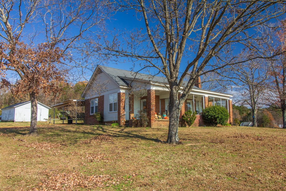 Brick Farmhouse Charmer For Sale in Selmer, TN on 2.88 Acres