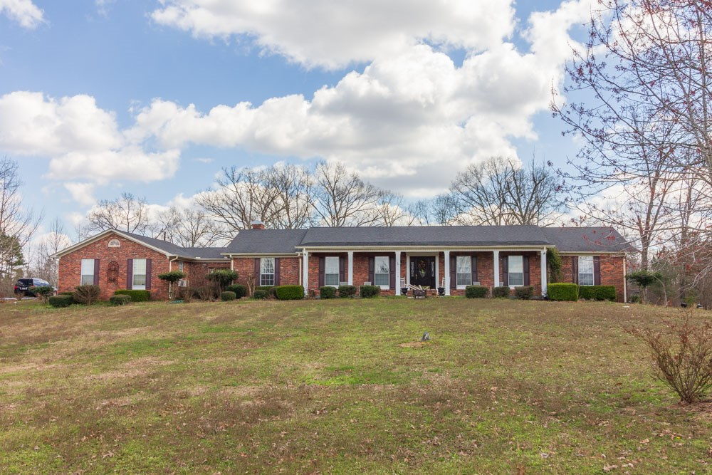 Classic Brick Home on Over 8 Acres in Selmer, TN