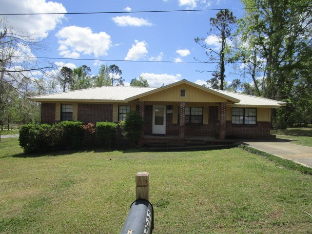 Remodeled brick home with metal roof in Blountstown