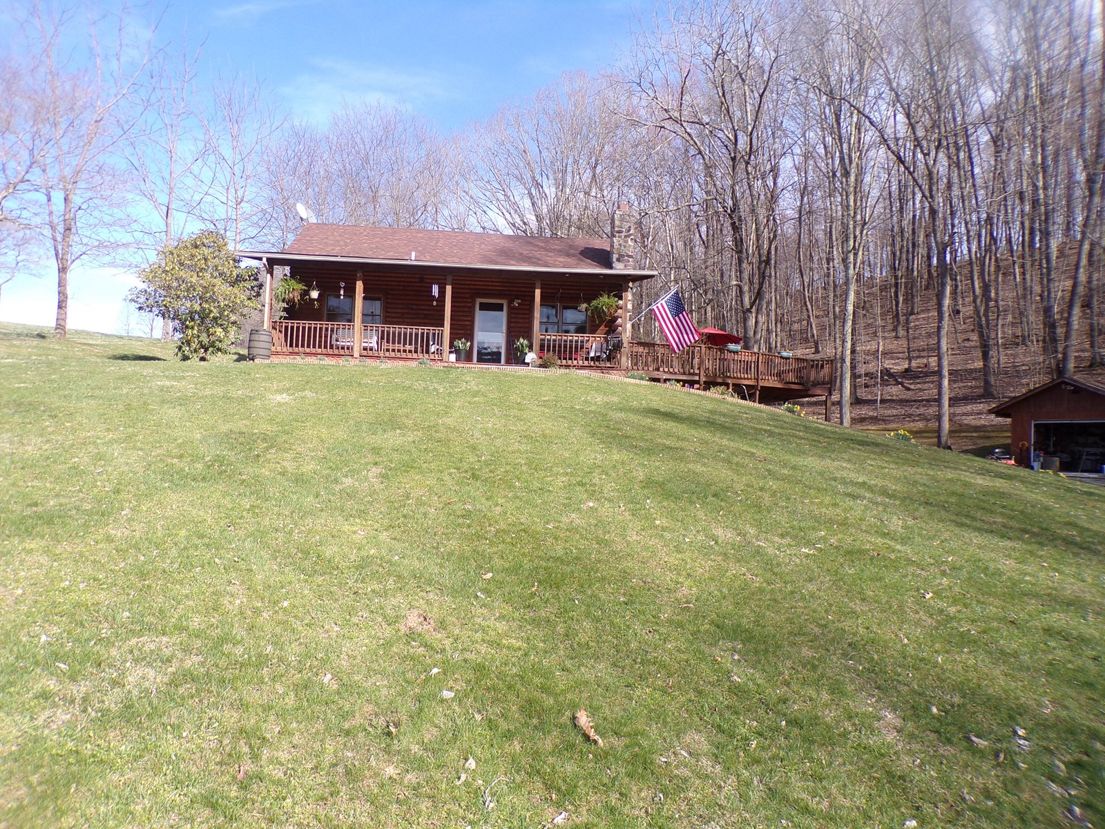 Log home for sale with 3 bedrooms and 2 baths
