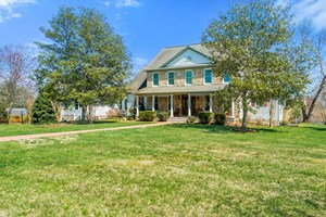 CUSTOM HOME WITH FULL FINISHED 3 LEVELS AND IN-LAW APARTMENT