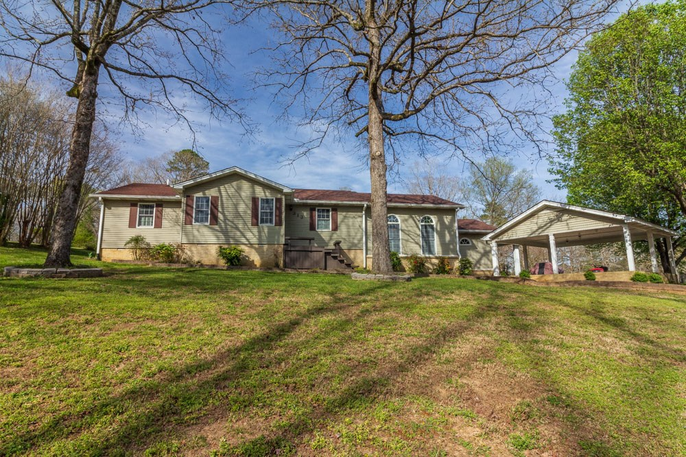Home Overlooking Fifth Fairway of Golf Course in Selmer, TN