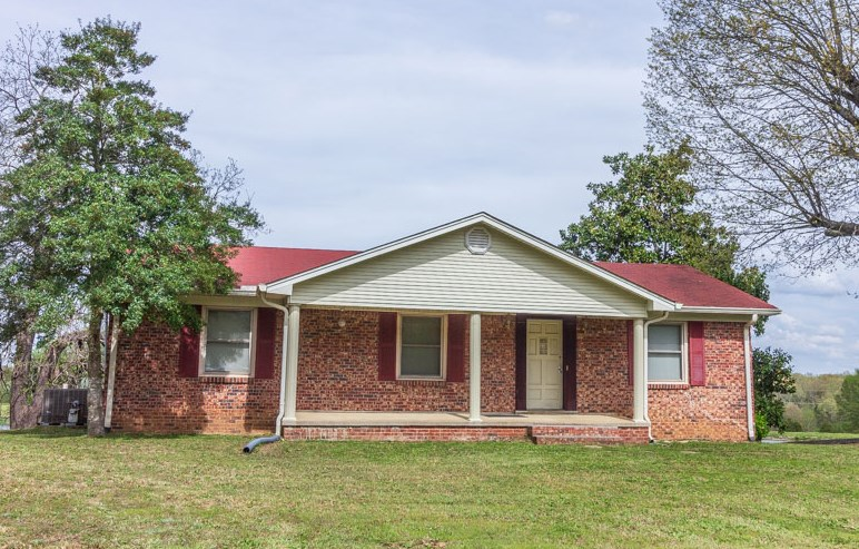 Classic Brick Country Home with Basement near Adamsville, TN