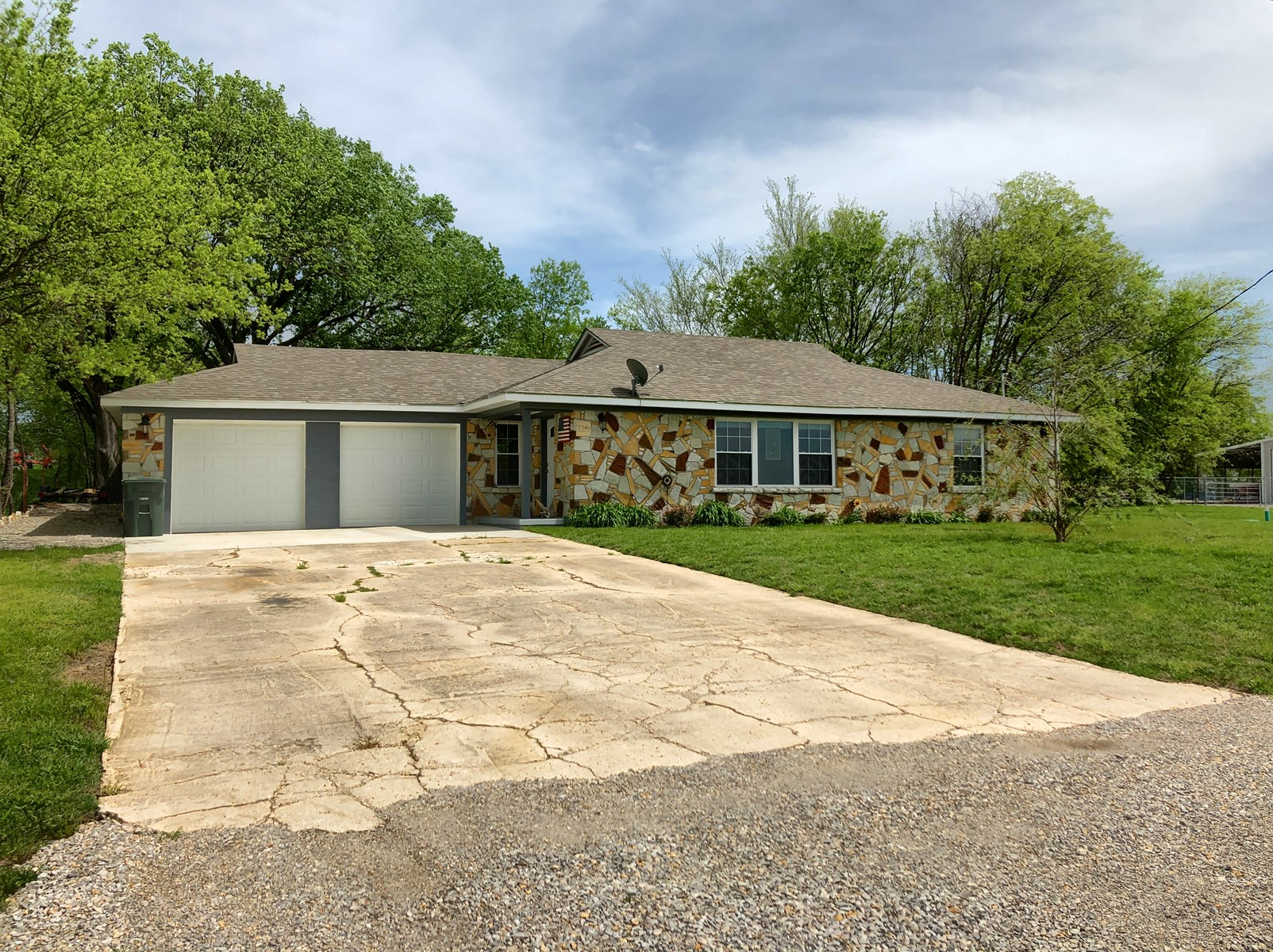 REMODELED ROCK HOME WITH ROOM FOR HORSES+ 2,000 SQ FT SHOP