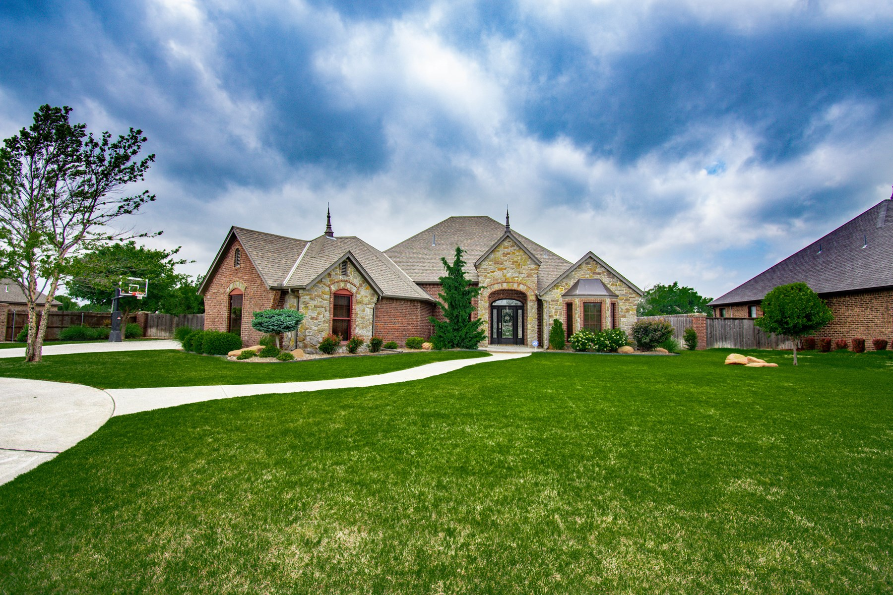 LUXURY HOME IN ELK CITY WITH SWIM SPA & UPSTAIRS BONUS ROOM