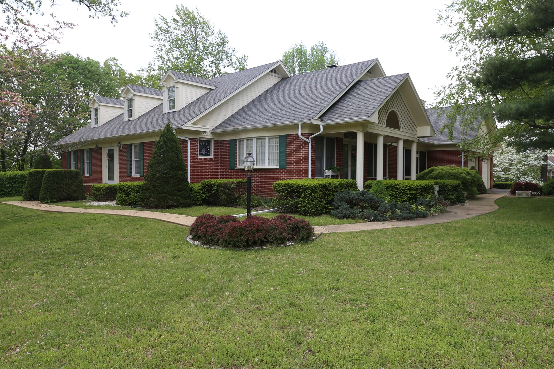 Executive Brick Home on large manicured lot in West Plains