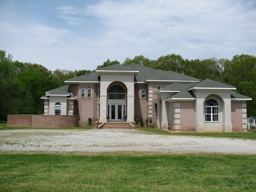 Private Luxury Home with Land For Sale in Whiteville, TN