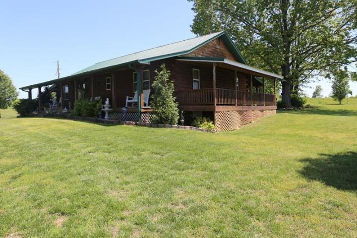 Custom Log Home on 20 acres in Heart of the Ozarks Missouri!