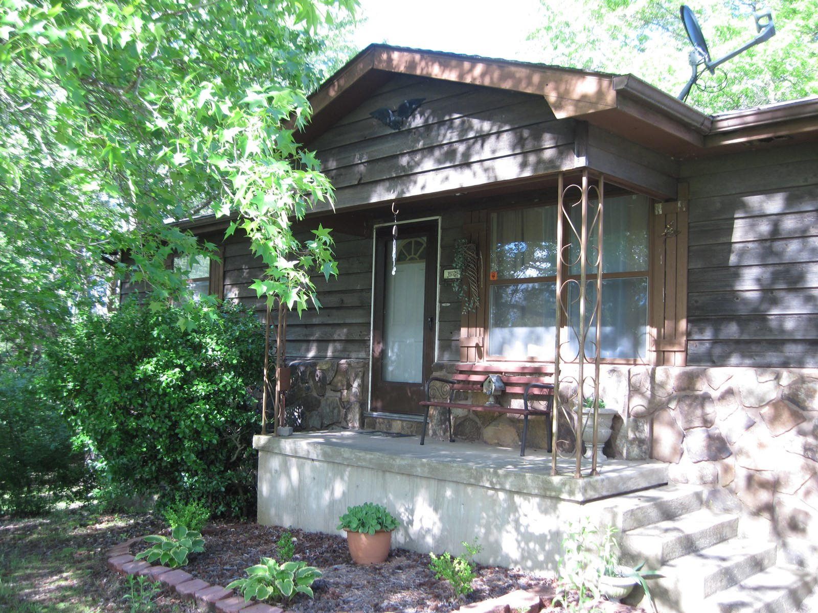 Nestled in the trees features this 3 bedroom, 2 bath home on