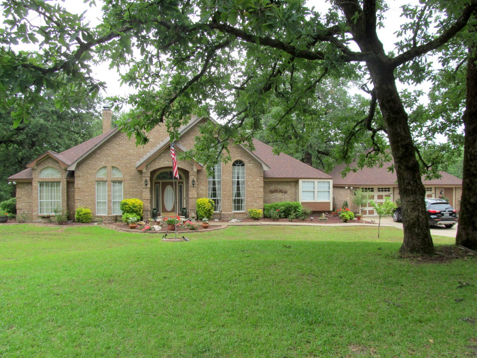 WoW! EAST TEXAS COUNTRY HOME ON SMALL ACREAGE WITH POND