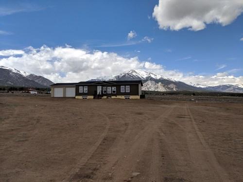 County Home Mountain Views New Home on Acreage in Colorado