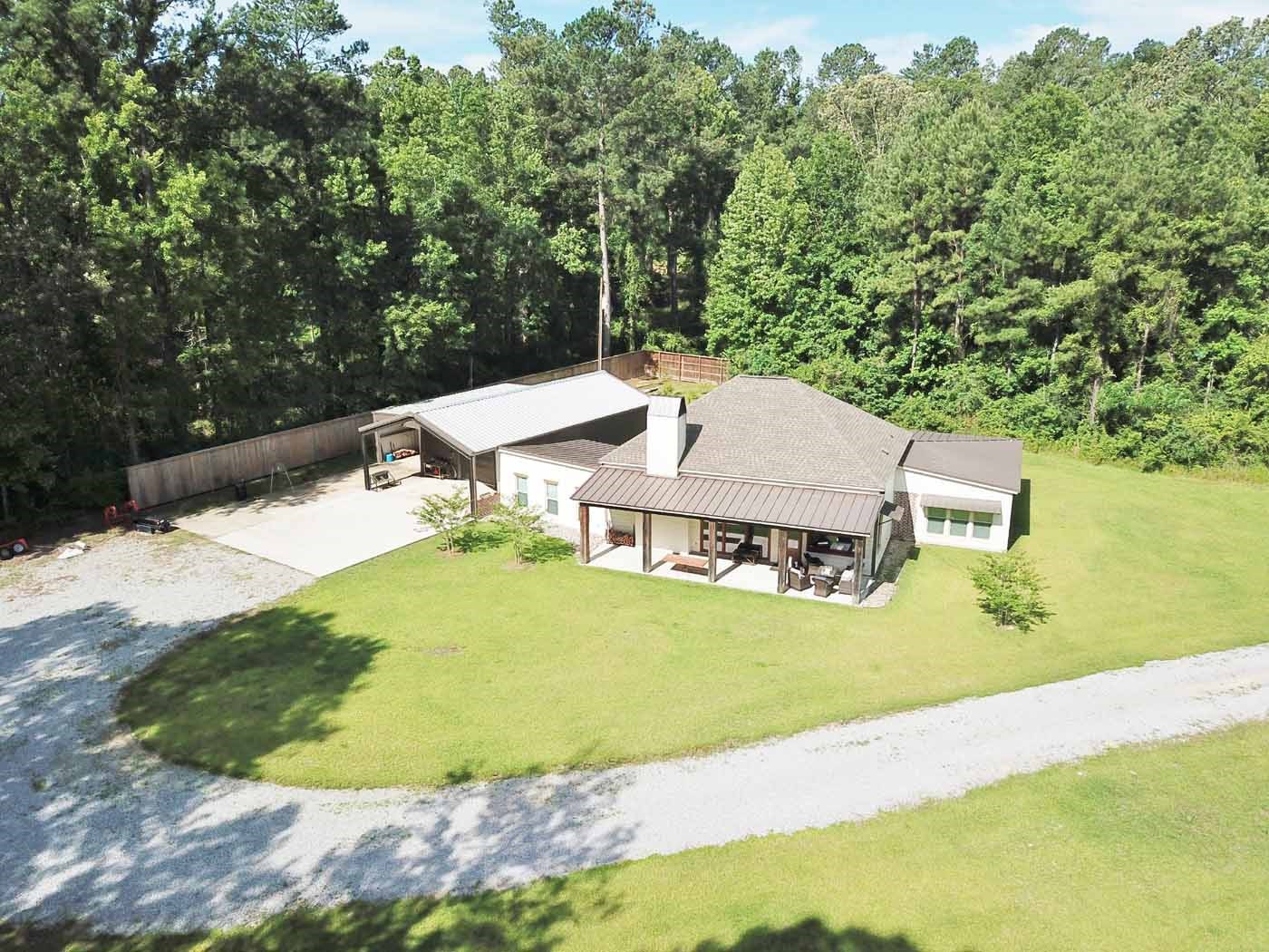 Hunting Lodge with Pond & Creek For Sale Wilkinson County MS