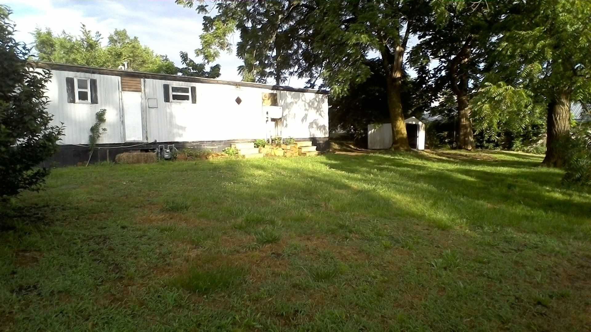 CITY LOT, MOBILE HOME