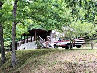 Mobile Home w/ 1 Acre 123 Moss Spring Hollow Rd $49,900