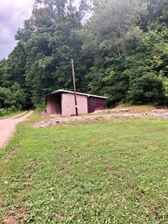1 Acre with building site and outbuilding $14,000