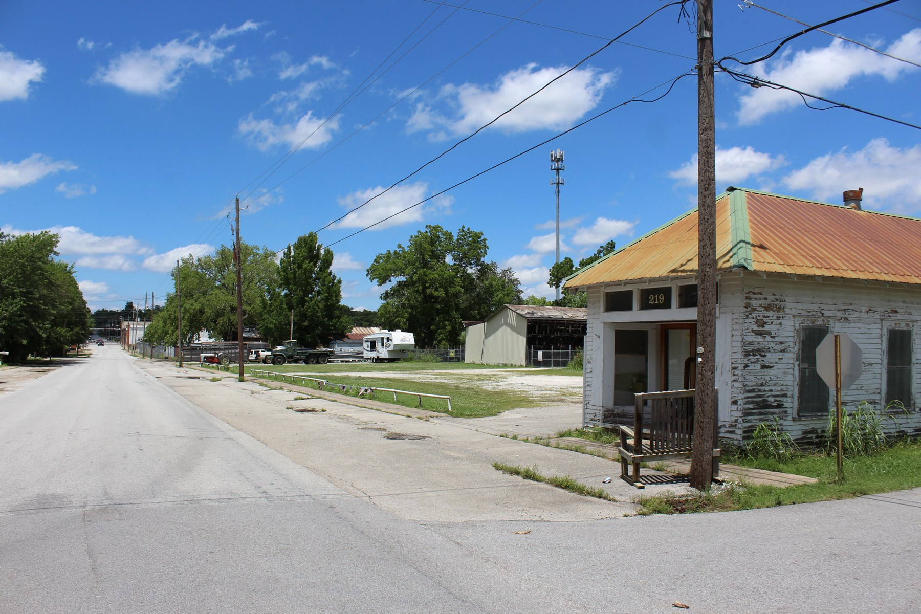 Prairie Grove Downtown Property With Acreage For Sale.