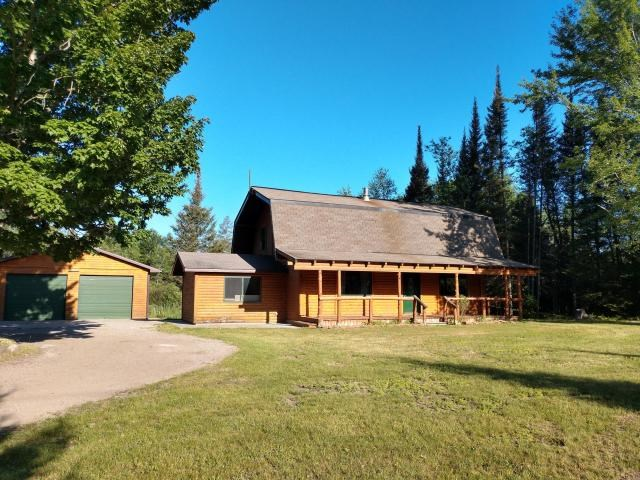 Log Home with 10 Acres and Pond for Sale Atlanta MI