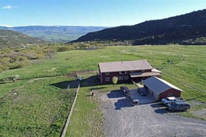 HOME, IRRIGATED ACREAGE, CREEK BORDERING PUBLIC LAND IN CO