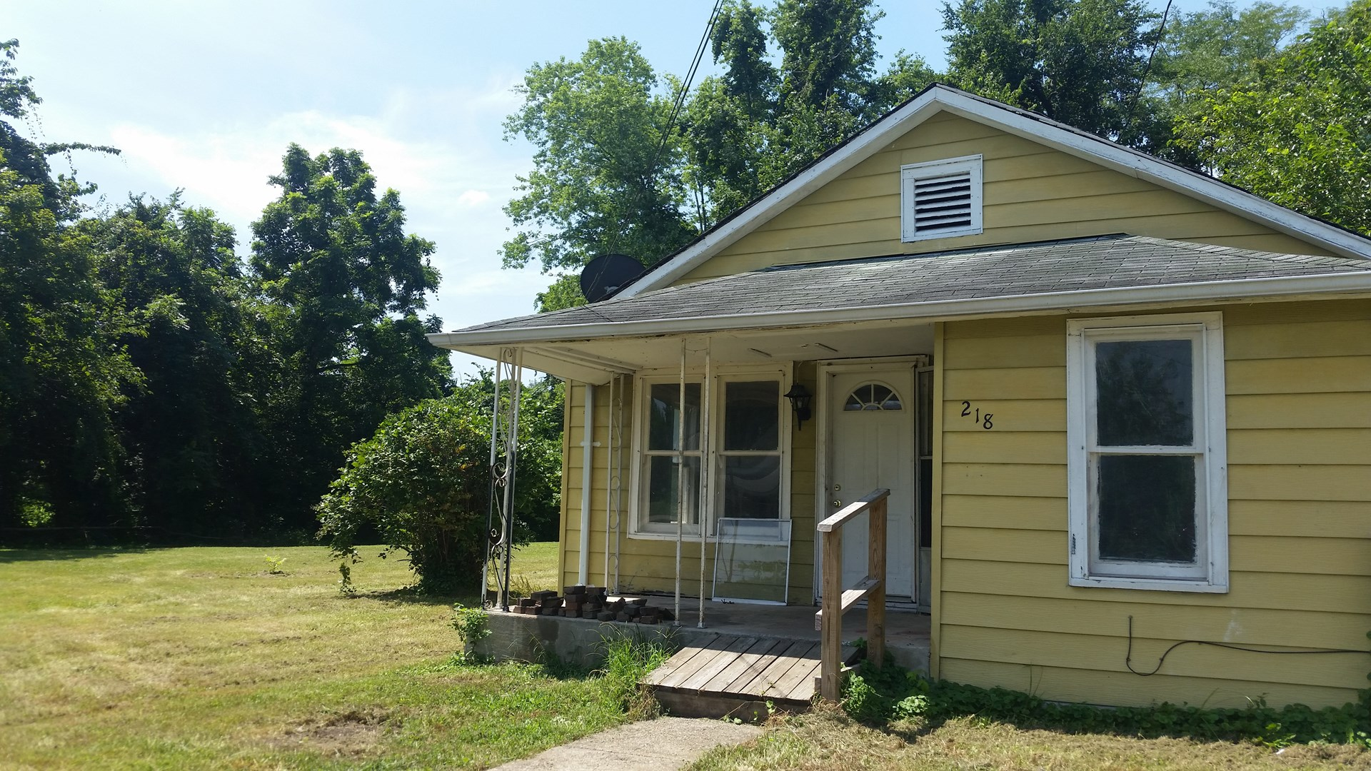 For Sale: 2 Bedroom 1 bath home on quiet street with huge ya