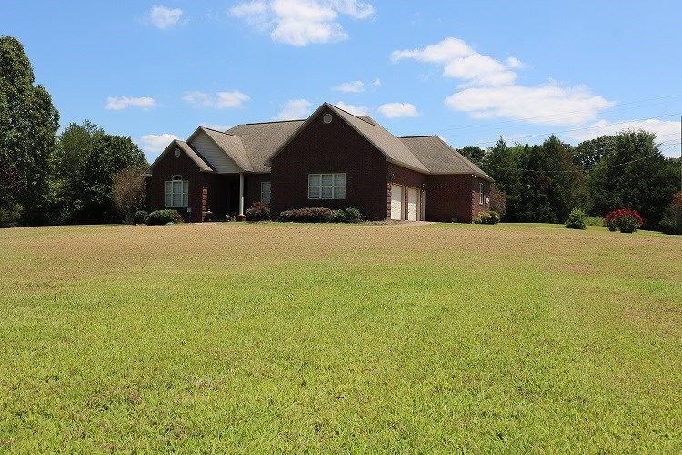 CUSTOM BUILT ALL BRICK HOME ON 11 ACRES & CREEK IN MELBOURNE